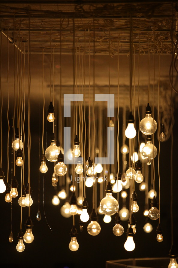 light bulbs hanging from a ceiling