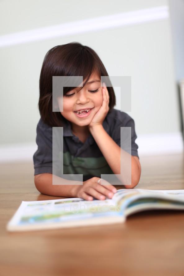 little boy missing teeth reading