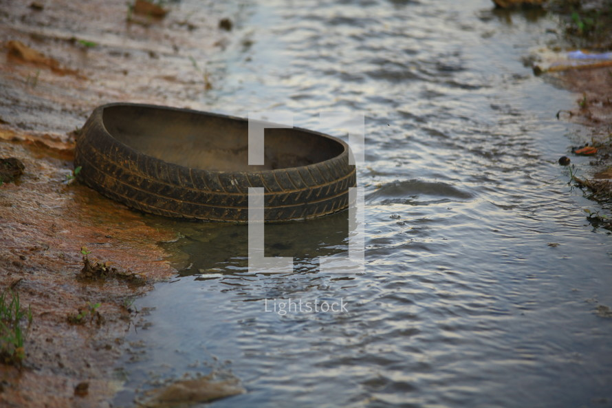 old tire in a small stream