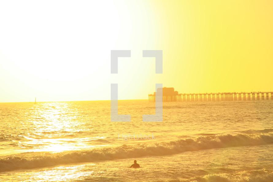 sun glowing over the ocean