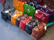 Leather bags for sale in the markets of Florence, Italy.