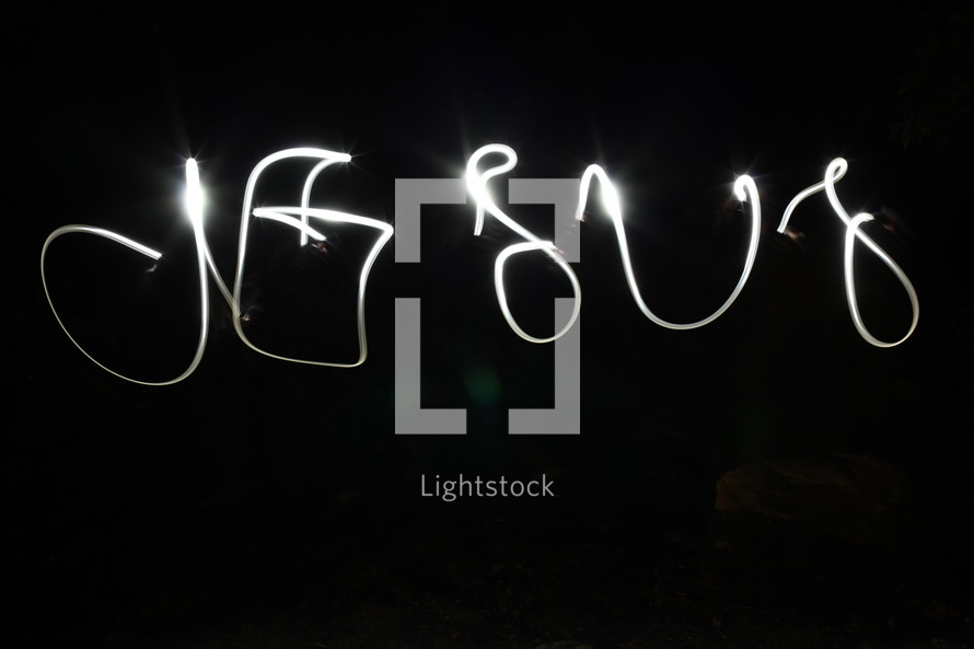 word JESUS written with sparklers
