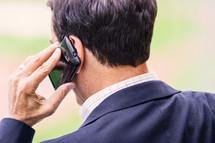 a businessman talking on a cellphone