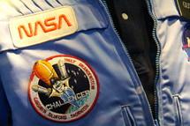 NASA astronaut waring Challenger Space Shuttle insignia