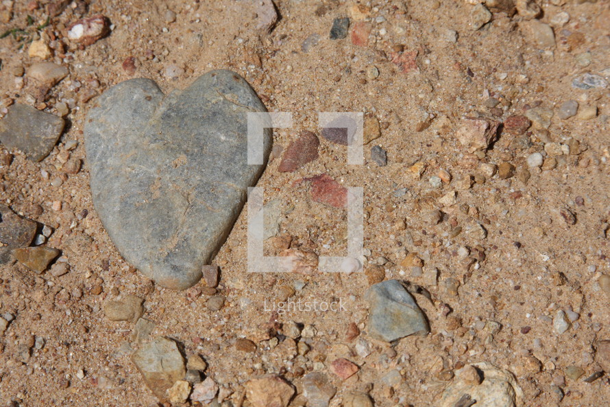 Heart shaped stone in the dirt