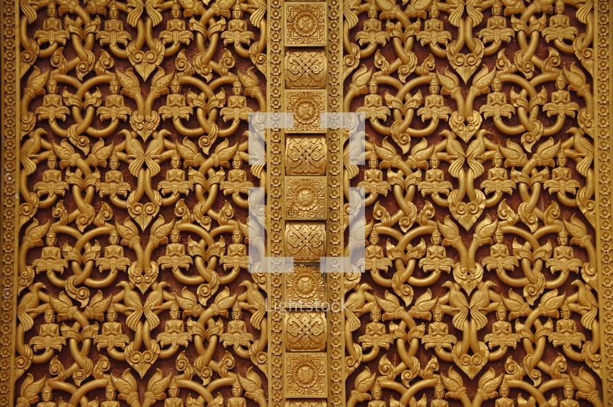 Ornate Buddhist temple door.