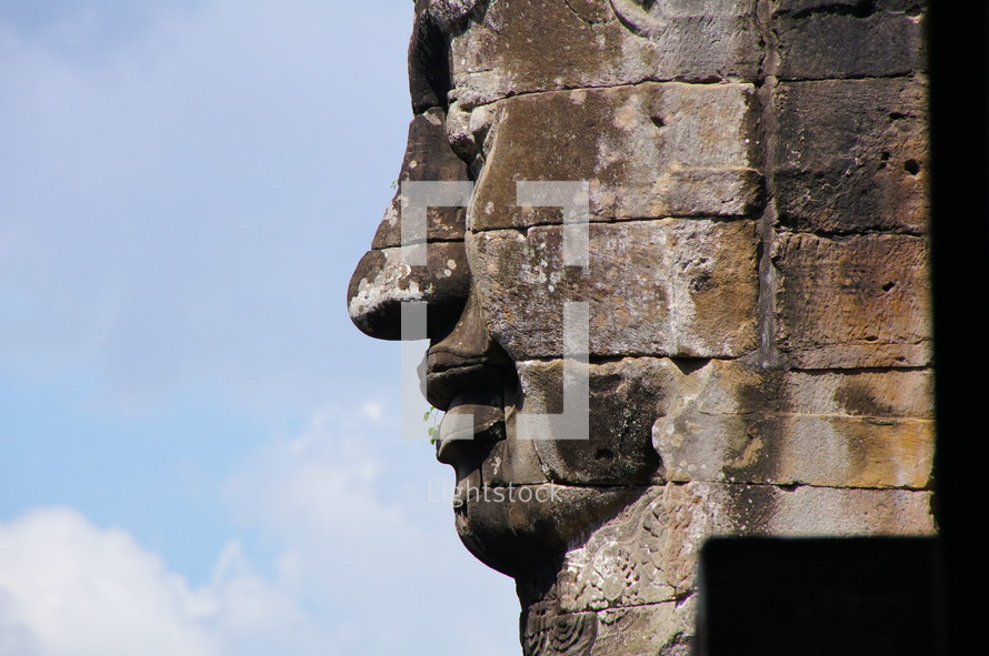 buddhist sculpture in towers of Bayon temple