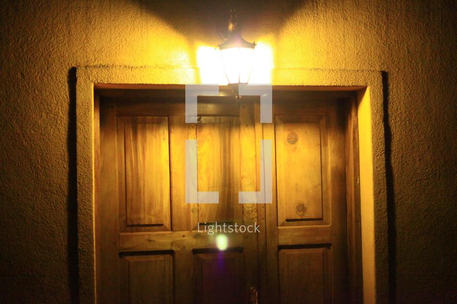 entryway light glowing over a doorway