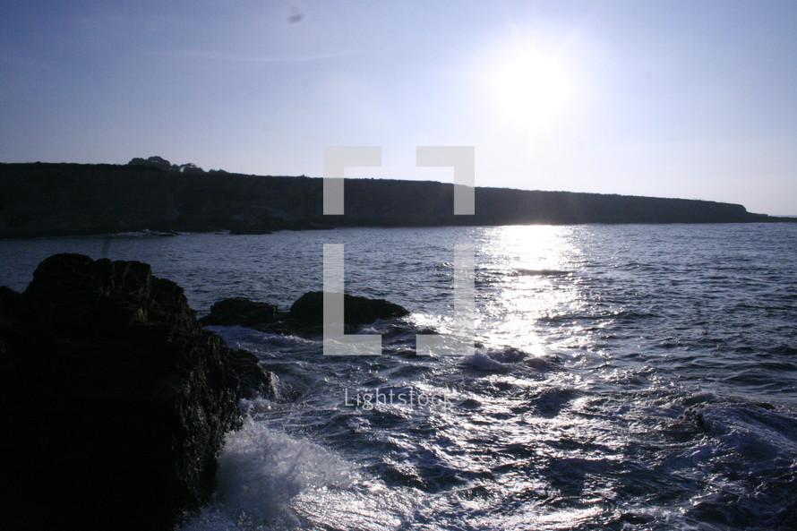 waves crashing into a rock