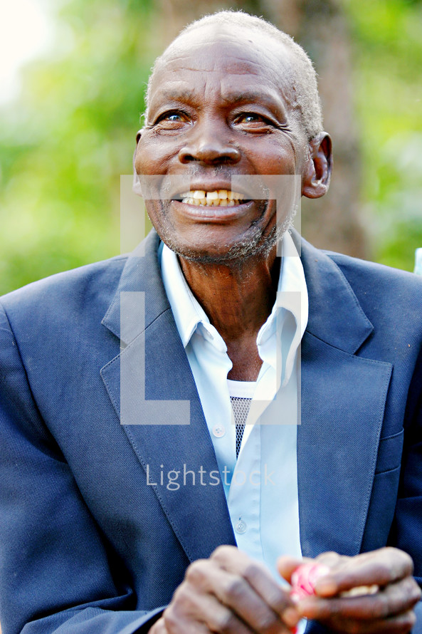 smiling african man in a blazer, uganda africa missions