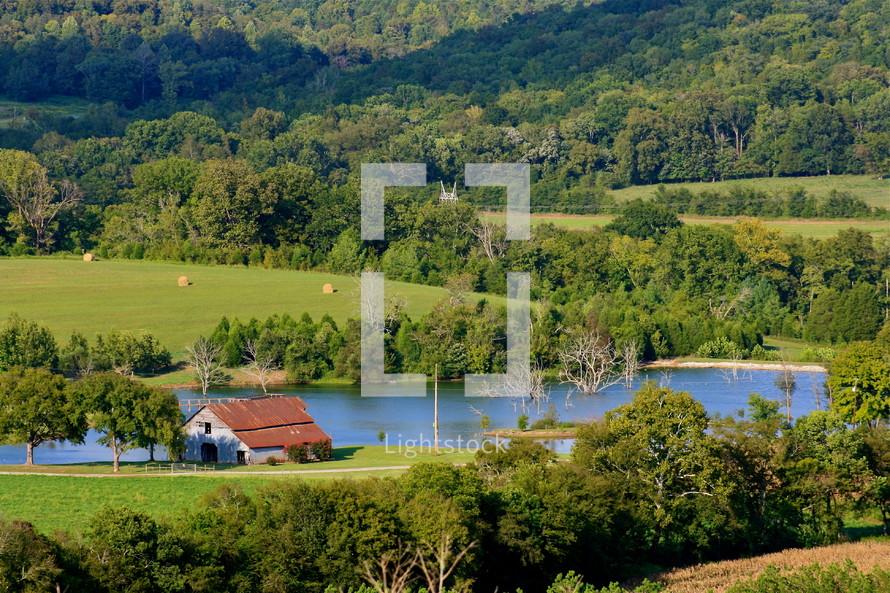 barn and pond on farm land