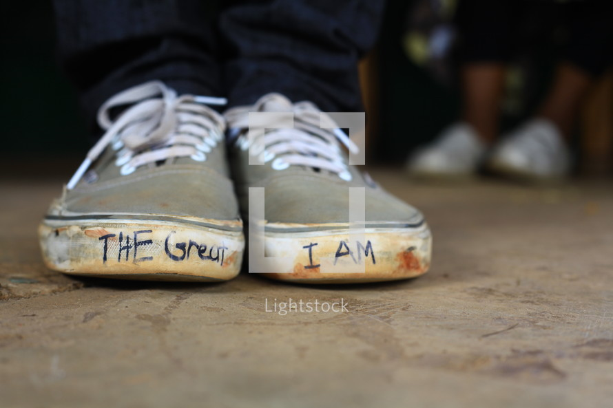 The great I am written on sneakers