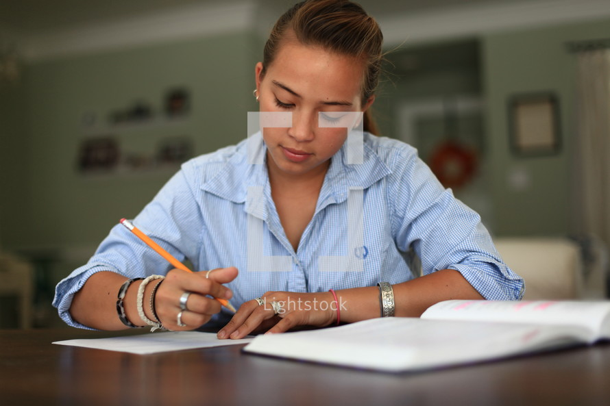 teen girl reading and writing