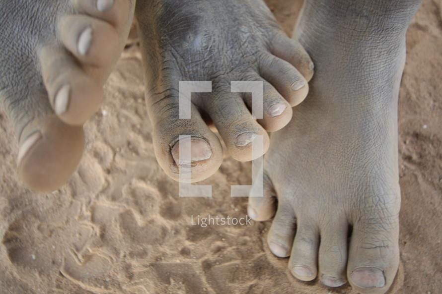 children's bare feet in the sand