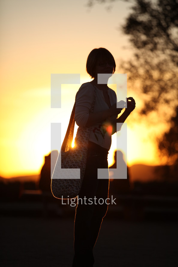 Woman standing in front of a sunburst