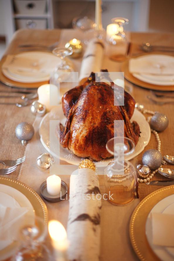 Roasted Turkey sitting on holiday table