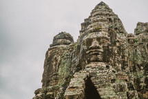 carved faces in temple ruins in Cambodia