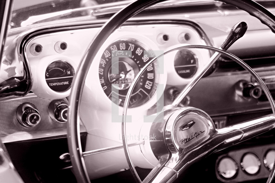 steering wheel and dash  of an old 57' chevy bel air car auto automobile automotive classic