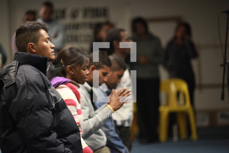 People worshipping and praying