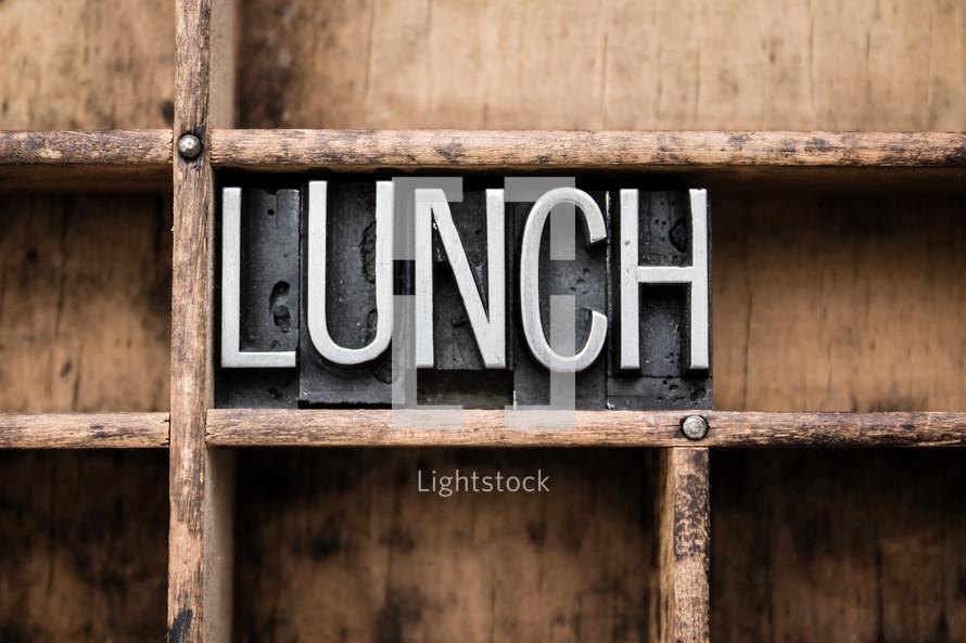 word lunch on a bookshelf