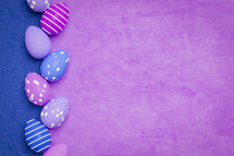 blue and purple background with Easter eggs
