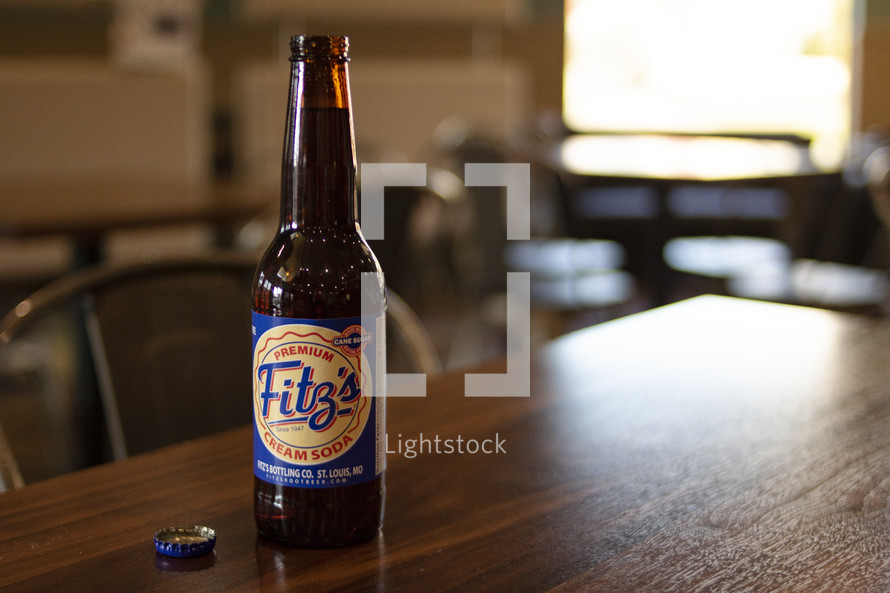 cream soda bottle on a wood table