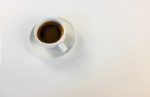 coffee cup and saucer on a white background
