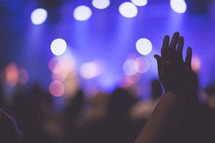 Raised hands in worship at church on Sunday morning.
