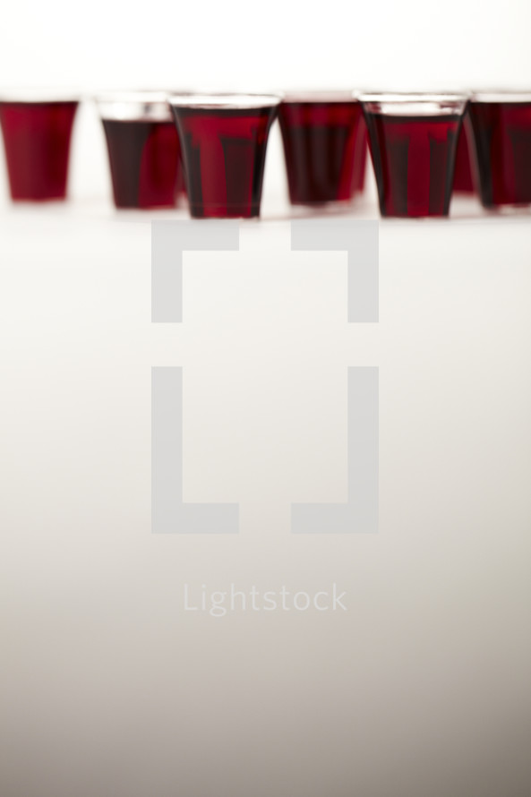 A set of communion cups on white seamless.