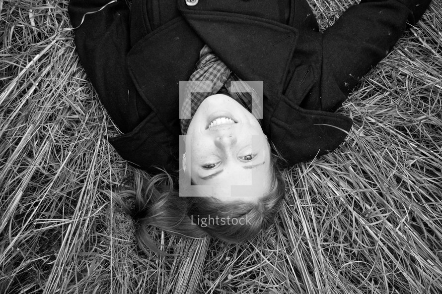 Woman laying in hay