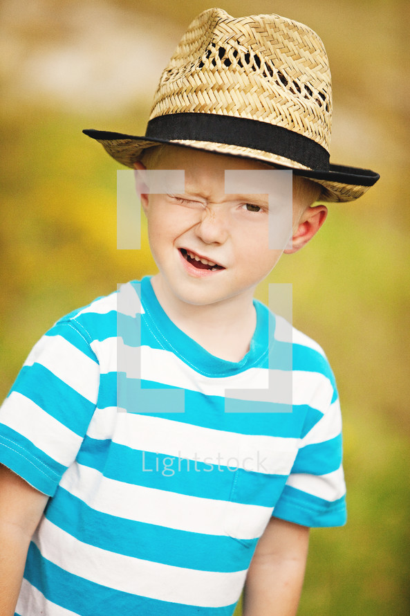 boy in a hat winking
