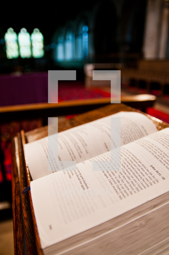 Open bible on a wooden stand