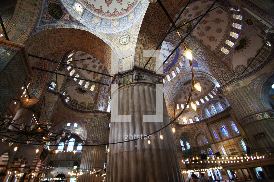 Ornate columns and ceiling in the Blue Mosque