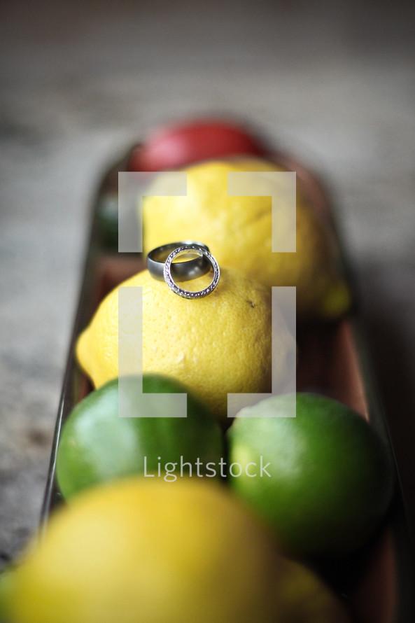 wedding bands on lemons and limes