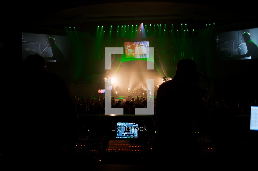 projection screens over a stage a concert