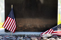 grave markers in a cemetery and American flags