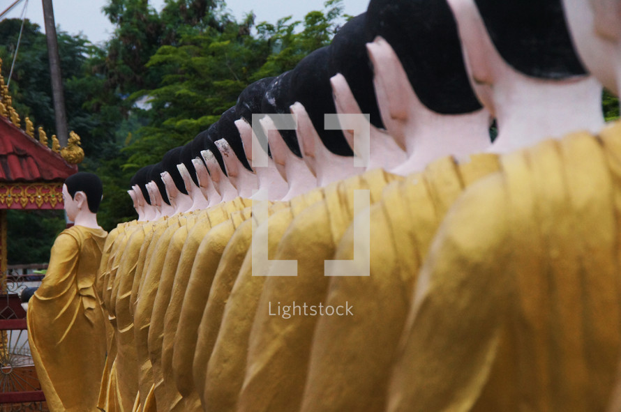 Statues of Buddhist monks dressed in robes