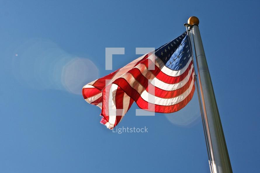 American flag flying on a flag pole