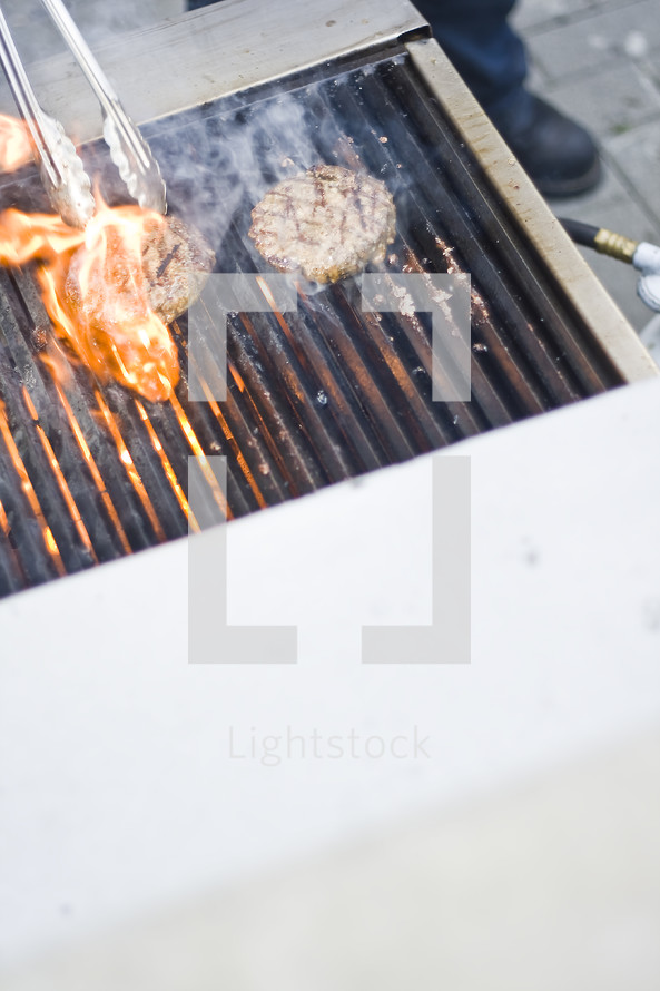 cooking hamburgers on a grill