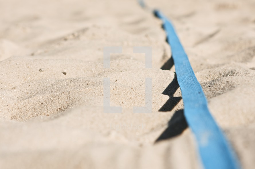 shoe lace in the sand