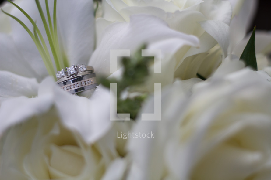 wedding rings on an Easter Lily