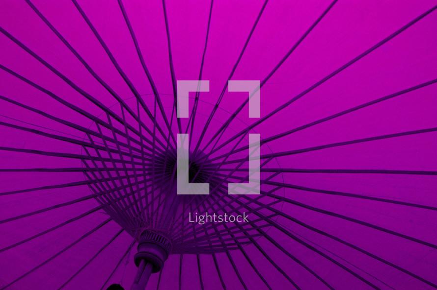 The inside of a purple parasol