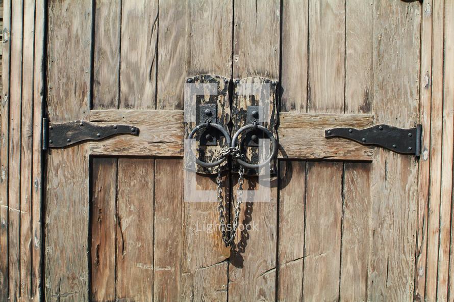 old wooden door with chain lock