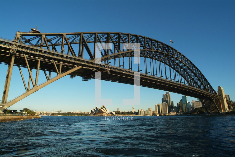 Sydney Harbor Bridge with the Opera House and Sydney Central Business District in the background.