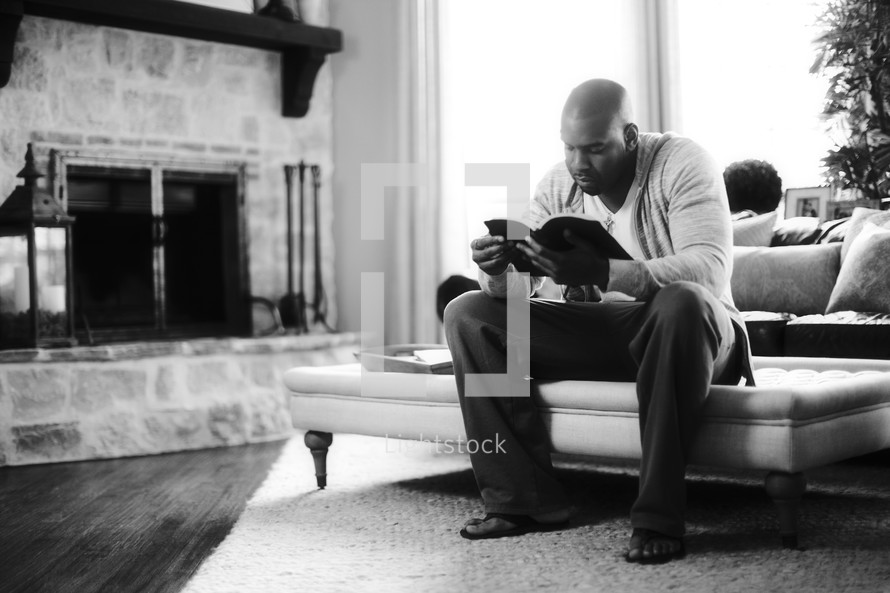 An African American man reading the Bible