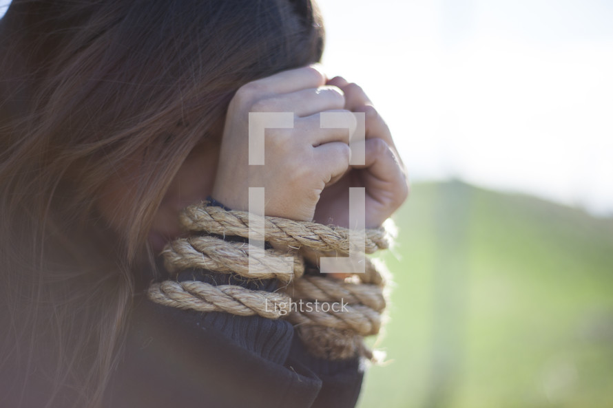 Arms tied in ropes