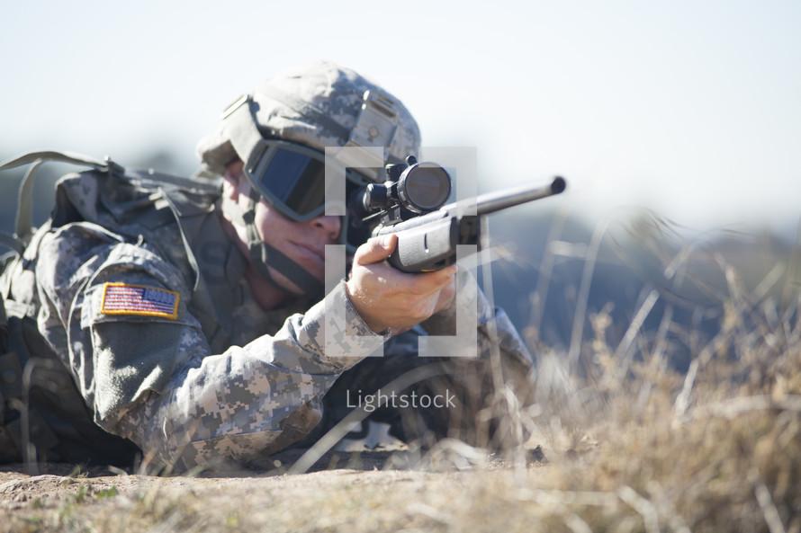 Soldier shooting machine gun