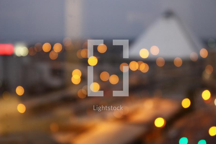 City lights. Bokeh. Blurry city background. City background.