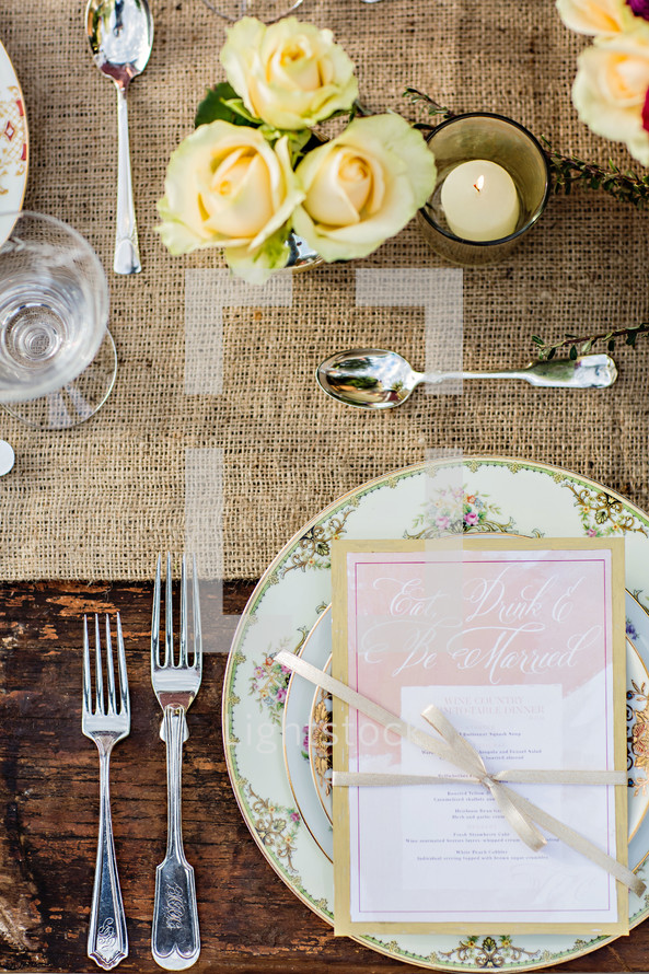 Place setting at wedding rustic chic plate fork spoon  menu country