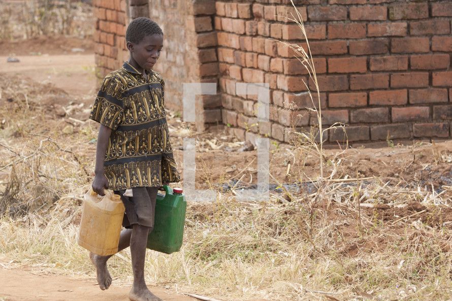 boy child carrying jugs of water